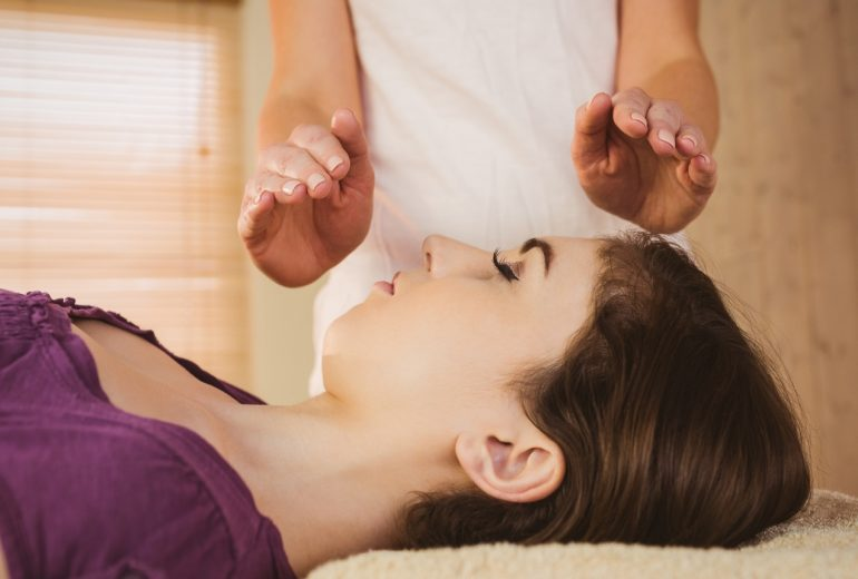 Woman having reiki performed on her in Liverpool